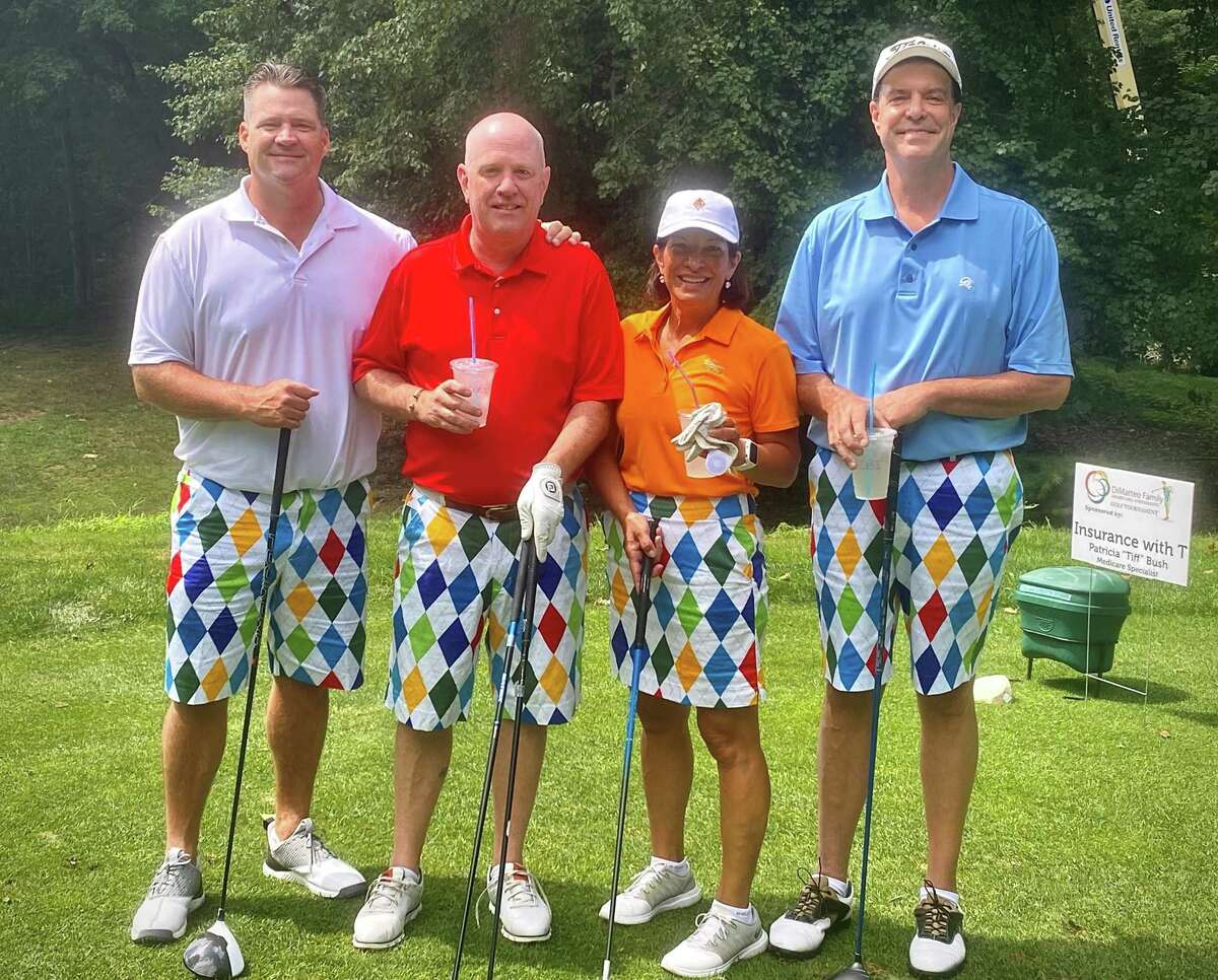 The best color-coordinated foursome that participated in the 15th annual DiMatteo Family Charitable Foundation Golf Tournament was organized by Vicki DiMatteo of Shelton, second from right. She is pictured with Vincent Grabowski of Newtown, far left; Michael Parsell of Monroe, second from left; and Michael Fortin of Shelton, far right.