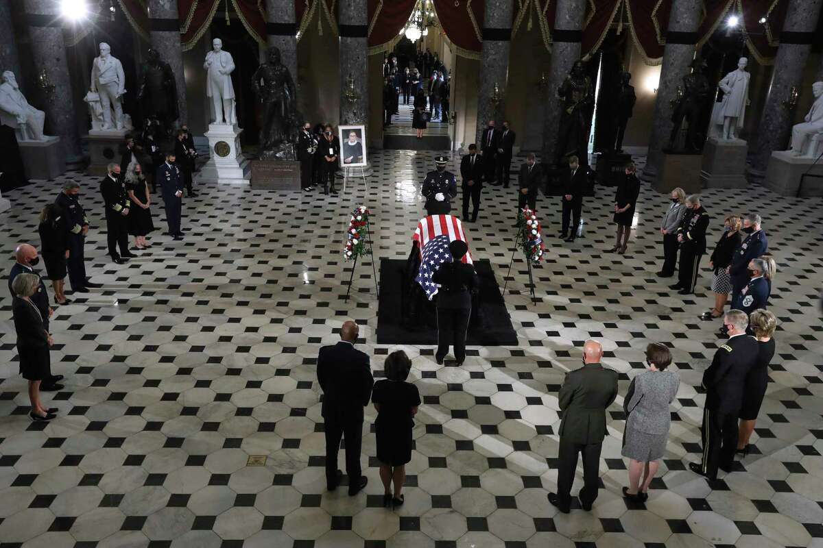 People pay their respects as Justice Ruth Bader Ginsburg lies in state at the U.S. Capitol on Friday. Polls show Americans want the next president to fill Ginsburg's seat.