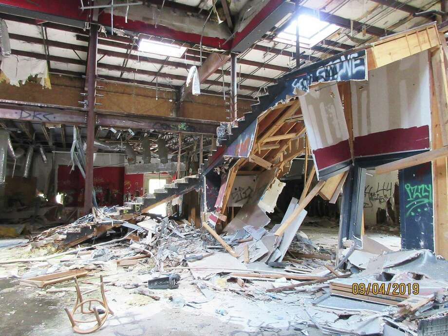 Since the fire in 2011, the stairway is collapsed along with numerous other walls and support beams. Charred remains from the club are strewn throughout the building and outside at the D. B. Cooper's Mansion Men's Club. Photo: Submitted
