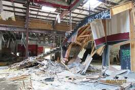 Since the fire in 2011, the stairway is collapsed along with numerous other walls and support beams. Charred remains from the club are strewn throughout the building and outside at the D. B. Cooper's Mansion Men's Club.
