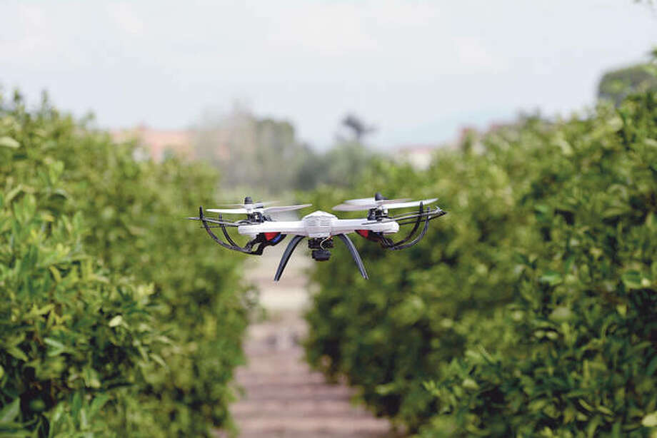 A drone flies through a cultivated area.