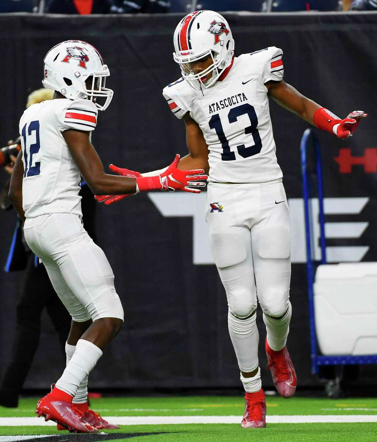Atascocita wide receiver Landed King (13) celebrates his touchdown with Keith Wheeler during the second half of a high school football playoff game against Dickinson, Saturday, Nov. 23, 2019, in Houston.
