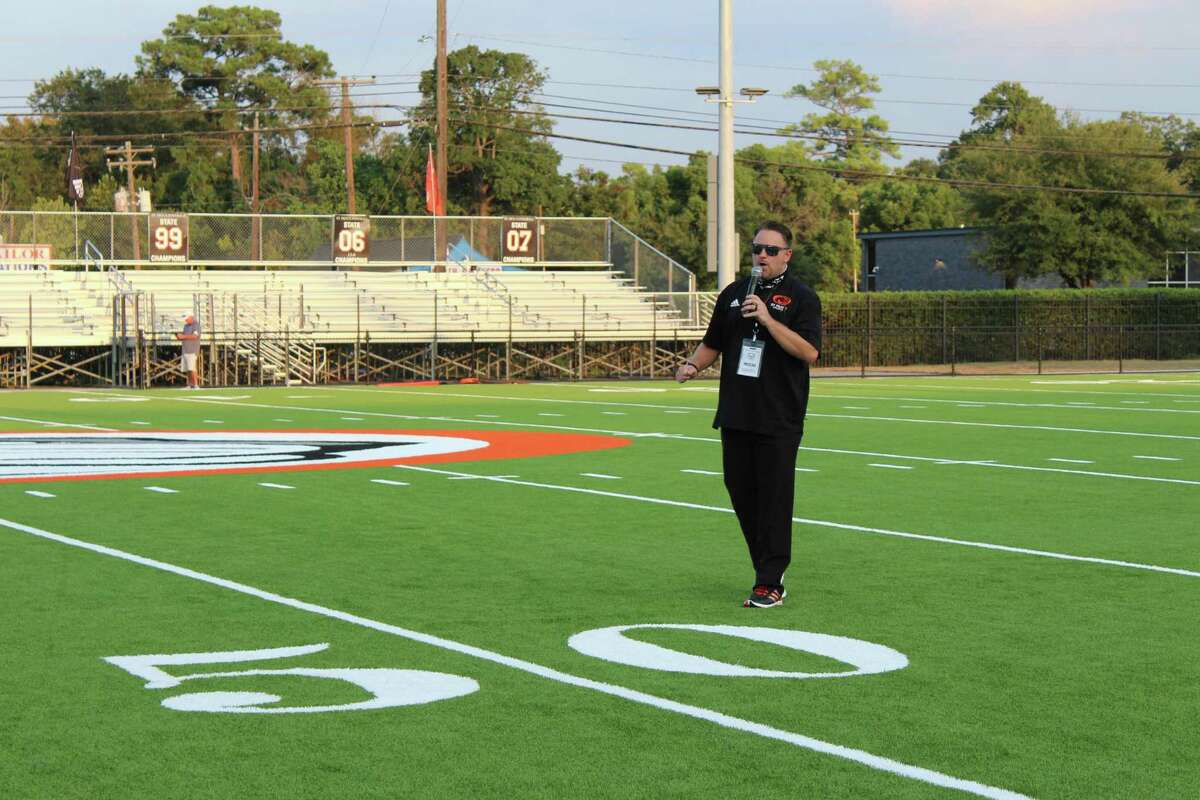 St. Pius X High School athletic director Jeff Feller speaks at the ceremony to dedicate the new turf field on Sept. 25, right before the start of the Panthers' first game of the 2020 season
