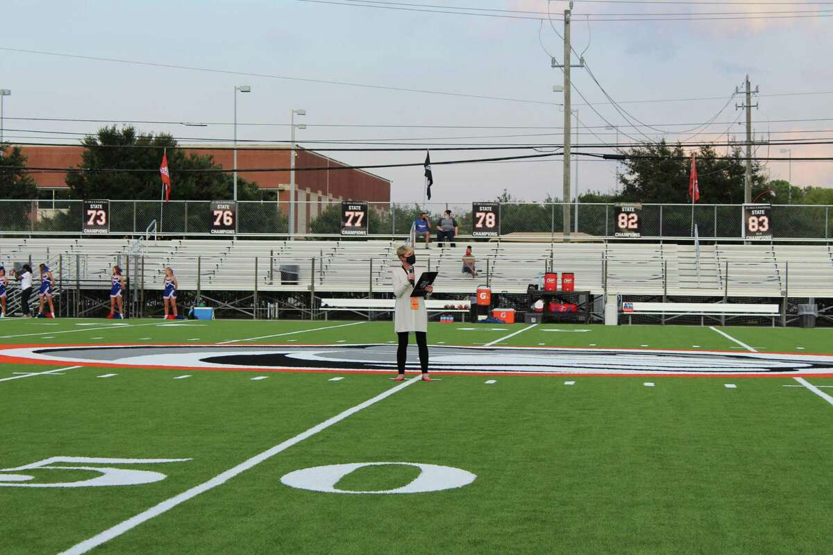 St. Pius X High School head of school Carmen Garrett Armistead speaks at the ceremony to dedicate the new turf field on Sept. 25, right before the start of the Panthers' first game of the 2020 season