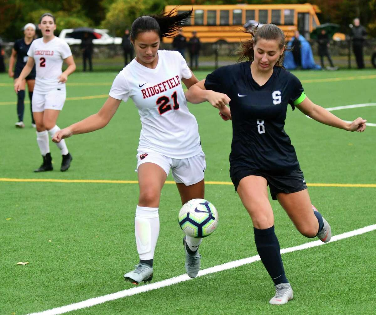 Action from a match between Staples and Ridgefield last season in Westport.