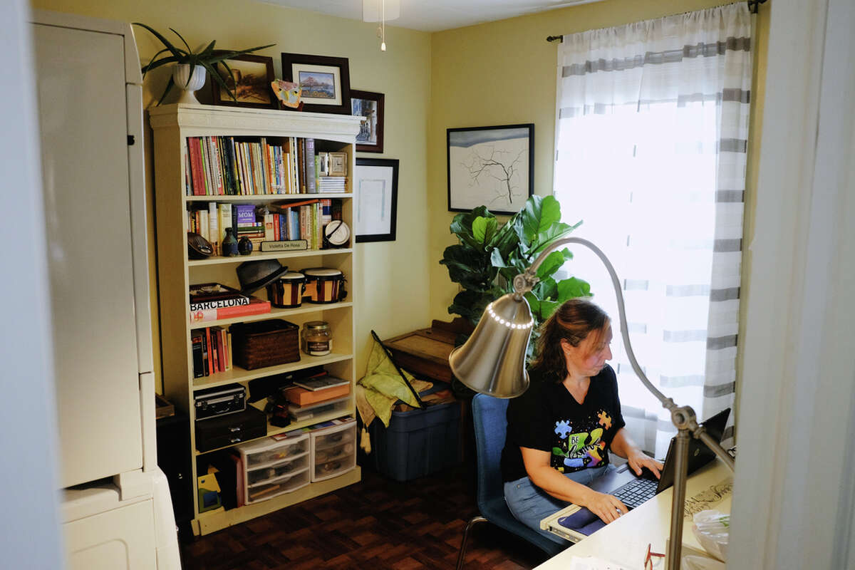 Violetta DeRosa, a teaching assistant, special education, for the Albany School District, works in her office at her home on Thursday, Sept. 24, 2020, in Albany, N.Y. This is were DeRosa would work with students and families when doing remote learning. (Paul Buckowski/Times Union)