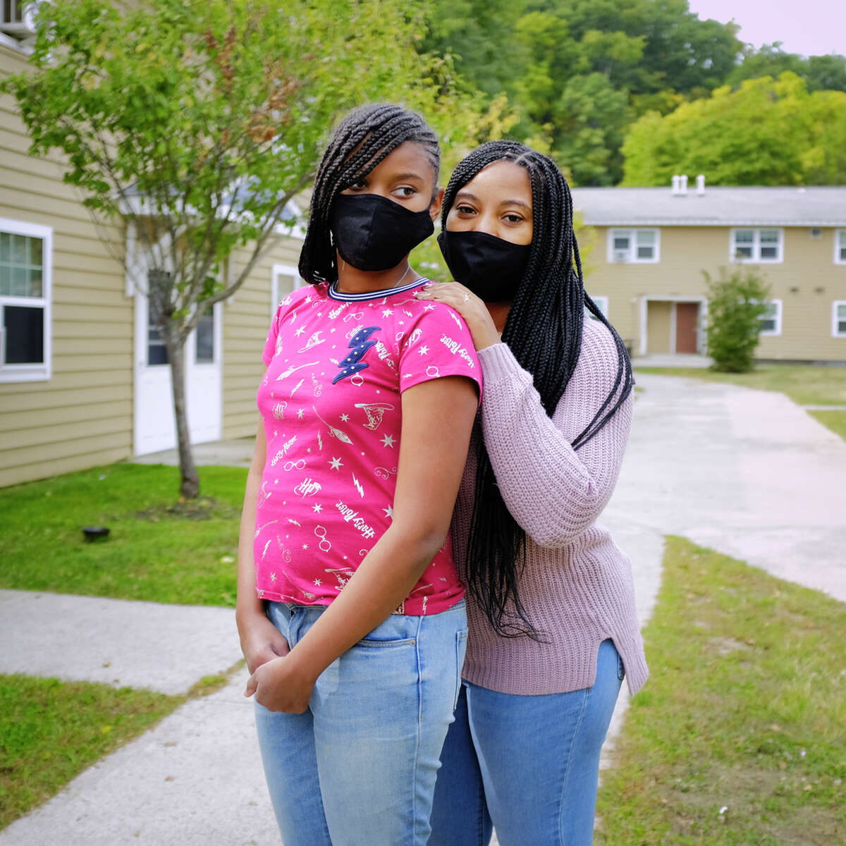 Akira Marshall, right, and her daughter, Damirah Corbitt, 12, outside their home on Thursday, Sept. 24, 2020, in Albany, N.Y. Corbitt is a home school coordinator at the Montessori Magnet School for the Albany School District. (Paul Buckowski/Times Union)