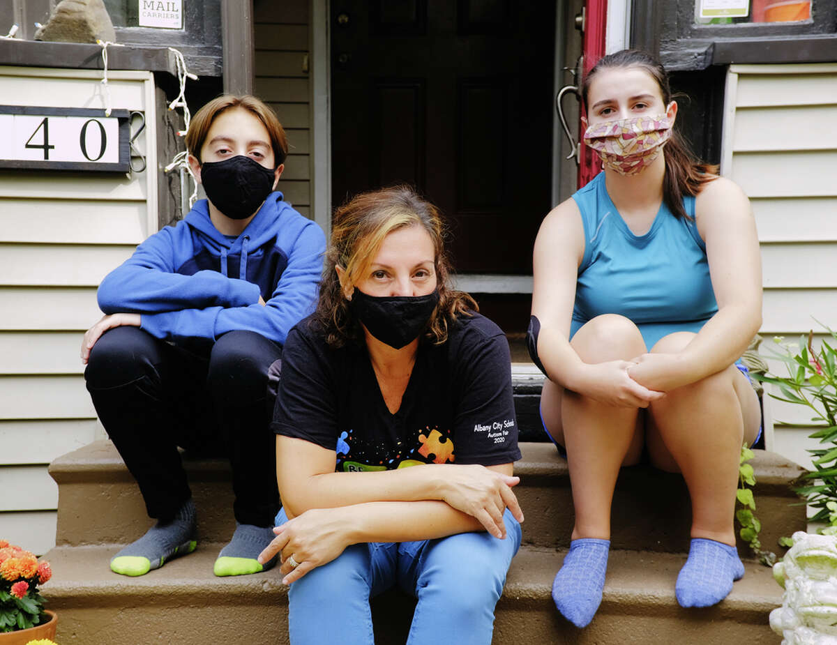 Violetta DeRosa, center, with her two children, Max DeRosa-Purcell, 13, and Edith DeRosa-Purcell, 17, at their home on Thursday, Sept. 24, 2020, in Albany, N.Y. DeRosa is a teaching assistant, special education, for the Albany School District. (Paul Buckowski/Times Union)