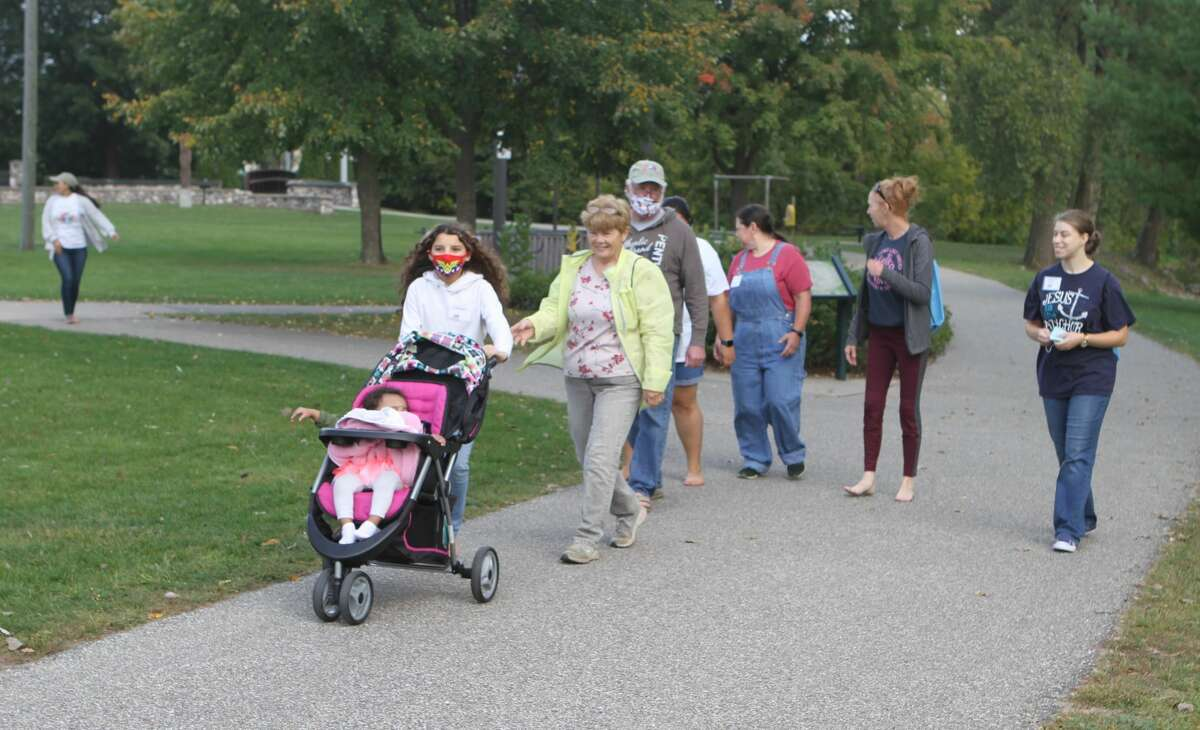 Hemlock Park was bustling with activity Saturday morning as Big Rapids area residents gathered to participate in the city's first Barefoot Mile Walk, sponsored by JOY International. Participants with the event helped raise money for this nonprofit organization and bring awareness to the issue of human trafficking while walking through the park. Although some attendees walked with bare feet, people did have the option to wear shoes.