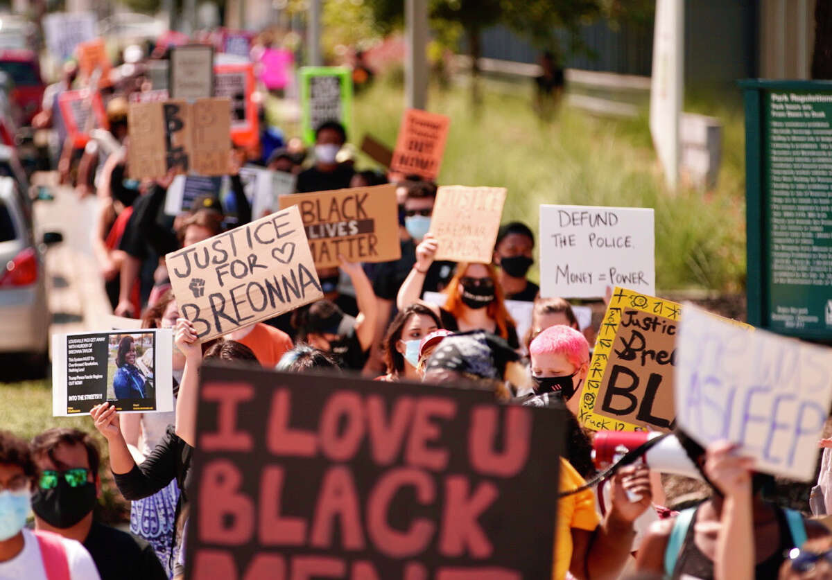 Demonstrators walk north on Emancipation Boulevard during a march to protest this week's grand jury decision in the killing of Breonna Taylor on Saturday, Sept. 26, 2020, in Houston.