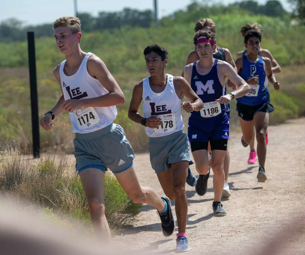 Lee's Bridger Bowcutt, from left, Christopher Lopez and Midland High's Logan Rutledge run along the Sibley Nature Trail during the Tall City Invitational on Saturday, Sept. 26, 2020 at Hogan Park. Jacy Lewis/Reporter-Telegram