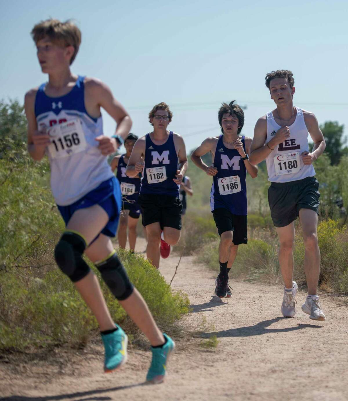 Midland Christian's Jay Ginsbach, from left, Midland High?•s Josef Kaderka and Alix Ortiz Dominguez and Lee?•s Ethan Nance run along the Sibley Nature Trail during the Tall City Invitational on Saturday, Sept. 26, 2020 at Hogan Park. Jacy Lewis/Reporter-Telegram