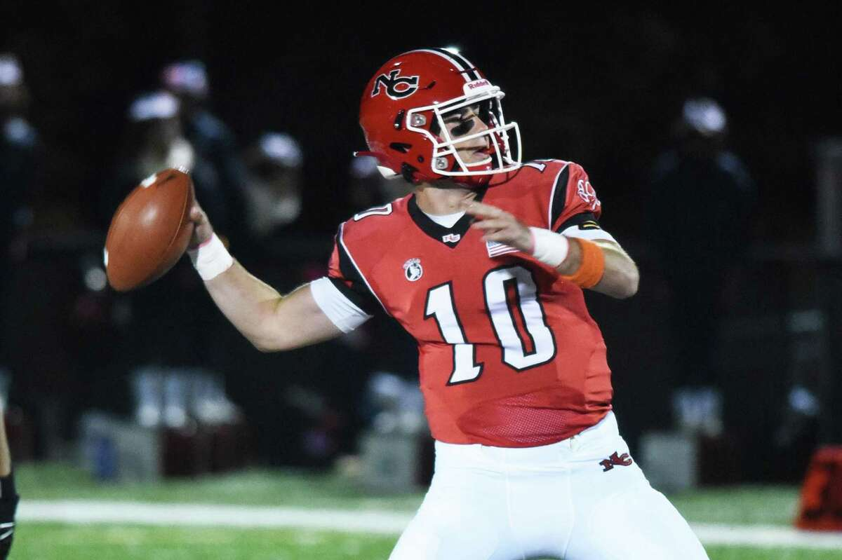 Drew Pyne (10) throws a pass during New Canaan's football game against Brien McMahon at Dunning Field on Nov. 1, 2019.