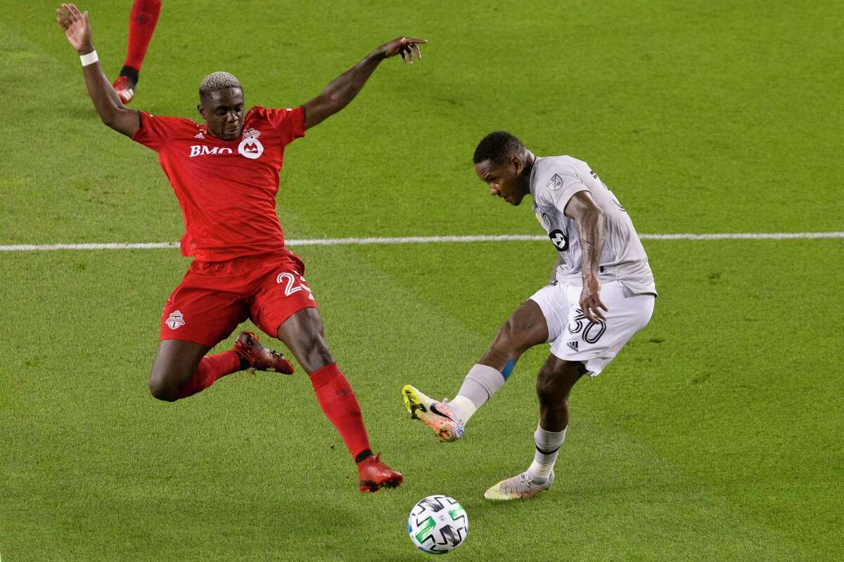 The Montreal Impact's Romell Quioto, right, gets a shot at goal despite pressure from Toronto FC's Chris Mavinga during an MLS match on Sept. 1. Mavinga leads Toronto against Columbus in the first of six games played at Rentschler Field.