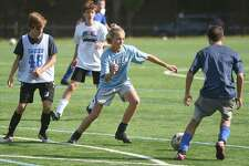 Darien's boys soccer players in action during the first day of full team practices at DHS on Monday, Sept. 21.