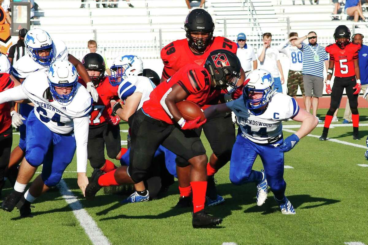 Clear Brook's Trent Lacy (22) is pursued by Friendswood's Ryan Helton (44) Saturday, Sep. 7 at CCISD Challenger Columbia Stadium.