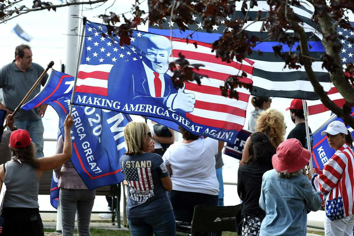 Supporters of President Donald Trump watch the Boaters for Trump and Blue Lives Matter Boat Parade at Branford Point on September 26, 2020. Boaters cruised the shoreline down to New Haven Harbor and back.