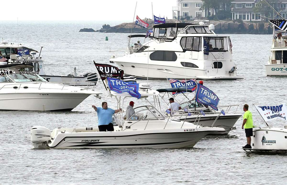 A Boaters for Trump and Blue Lives Matter Boat Parade organized by Todd Petrowski (center left pointing) of Branford begins at Branford Point on September 26, 2020. Boaters cruised the shoreline down to New Haven Harbor and back. Petrowski, who is not a boat owner, participated on a friend's vessel, a 27-foot fishing boat.