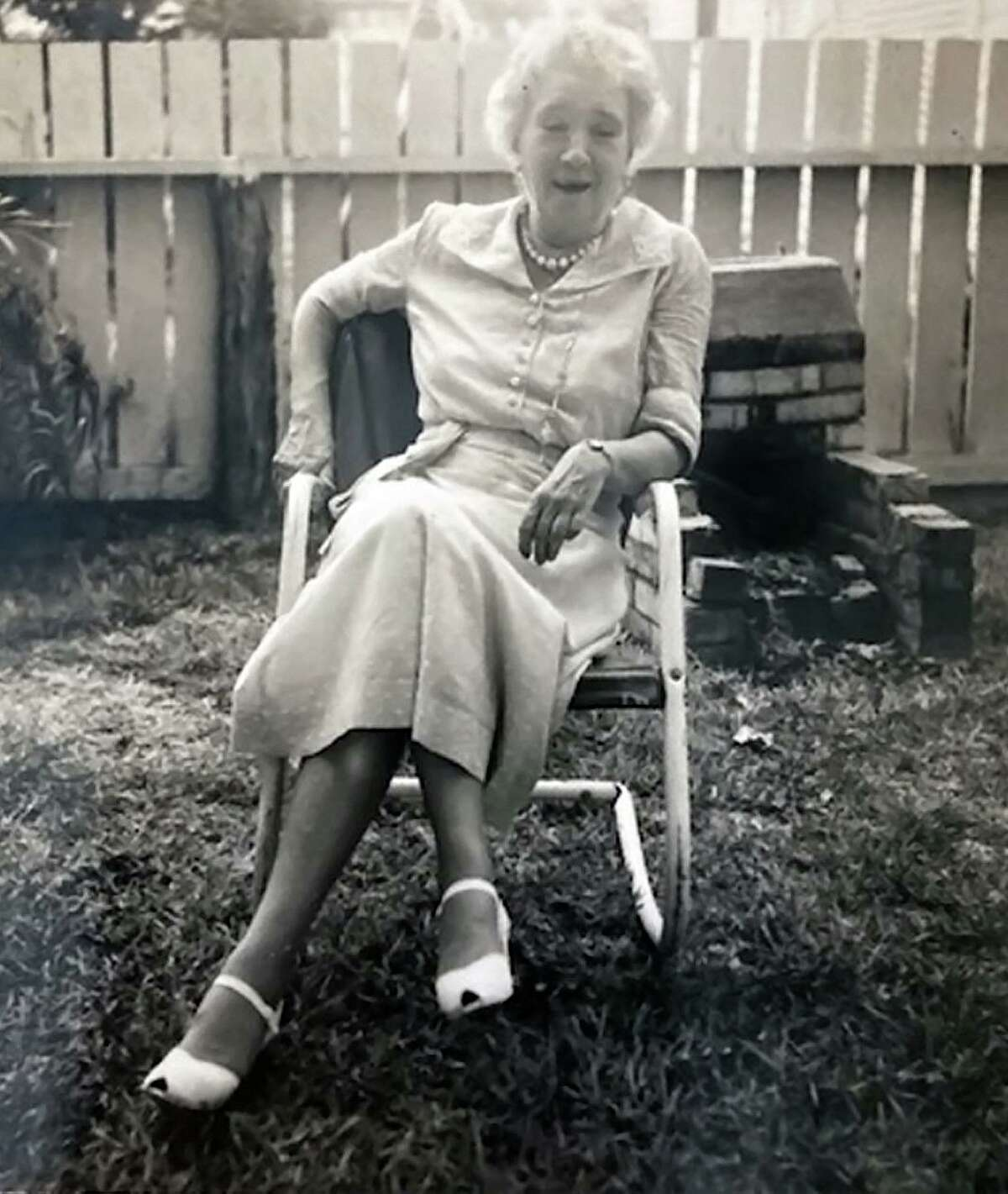 """Still active in her 60s, Penelope """"Nellie"""" Borden relaxes in the backyard of her home at 117 Jackson St. in the downtown San Antonio area, near the high school now known as Fox Tech. Borden was a music teacher at that school, previously known as Main Avenue High School, and was also the music editor and columnist for the San Antonio Express. And she wrote for the San Antonio Light."""