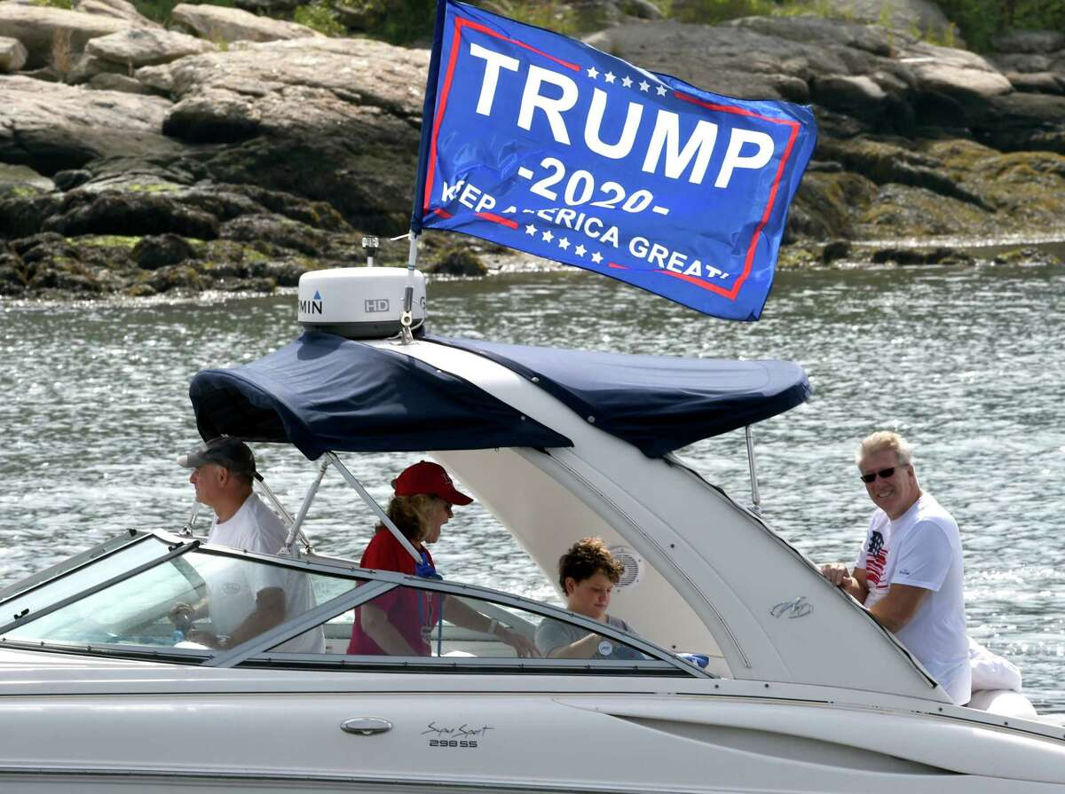 The Boaters for Trump and Blue Lives Matter Boat Parade returns to Branford Point on September 26, 2020 after cruising the shoreline down to New Haven Harbor and back. As nearly 150 power boats, yachts, day sailers, kayaks and dinghies boats, adorned with Blue Lives Matter, Trump 2020 and American flags, passed by the Branford Point fishing pier, supporters on land blew air horns, shouted support and waved their own flags.
