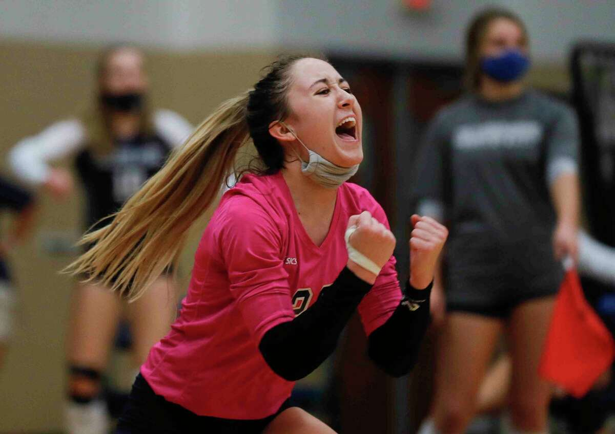 College Park libero Alexis McDaniel yells during the first set of a non-district high school volleyball match at College Park High School, Saturday, Sept. 26, 2020, in The Woodlands.