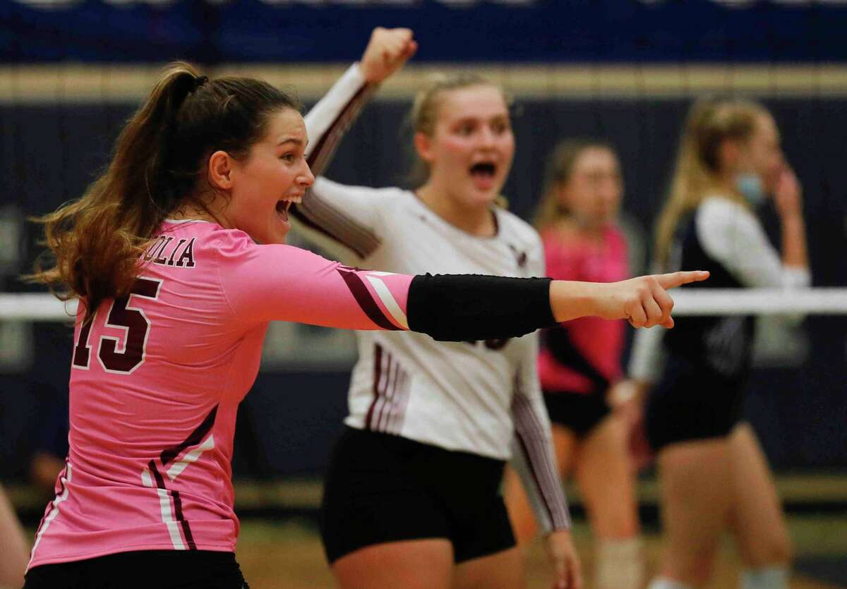 Magnolia's Kaylyn Fojt (15) reacts after a point during the first set of a non-district high school volleyball match at College Park High School, Saturday, Sept. 26, 2020, in The Woodlands.