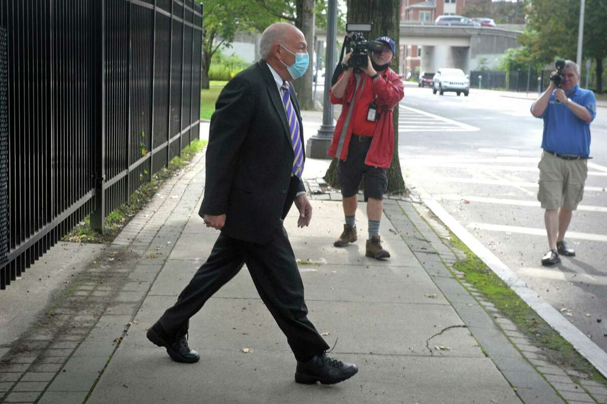 Bridgeport Police Chief Armando Perez leaves the federal courthouse in Bridgeport, Conn., Thursday, Sept. 10. 2020. Perez and the city's acting personnel director, David Dunn, were both arraigned on Thursday on federal charges. Mayor Joe Ganim said that Chief Perez resigned and that he named Assistant Chief Rebeca Garcia as acting chief after federal prosecutors in New York and FBI officials in Connecticut announced the arrests of Perez and Dunn. (Ned Gerard/Hearst Connecticut Media via AP)