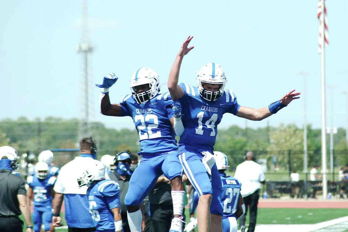 Clear Springs wide receiver Kaleb Hymes (22) and quarterback Luke Sampson (14) celebrate a touchdown by Sampson against Katy Saturday at Challenger Columbia Stadium.