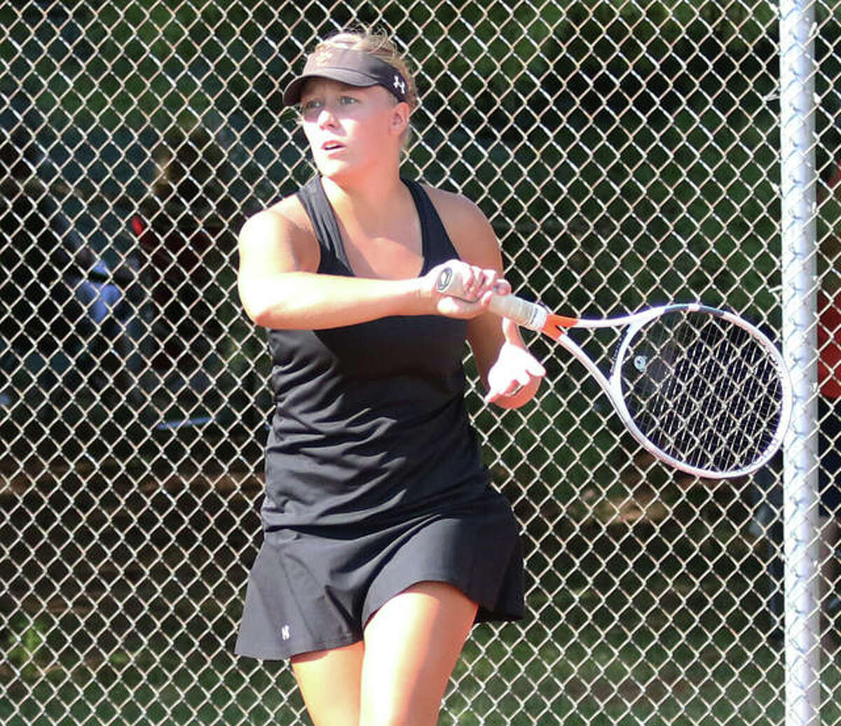 Edwardsville junior Hannah Colbert watches her shot during a No. 2 singles match against Jersey on Friday at the EHS Courts in Edwardsville.