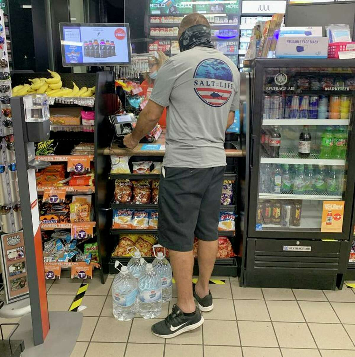 A customer buys water at the Circle K at Oyster Creek Drive and Lake Road in Lake Jackson late Friday shortly after news spread of a do-not-use order from Brazosport Water Authority. (MADDY McCARTY/The Facts)