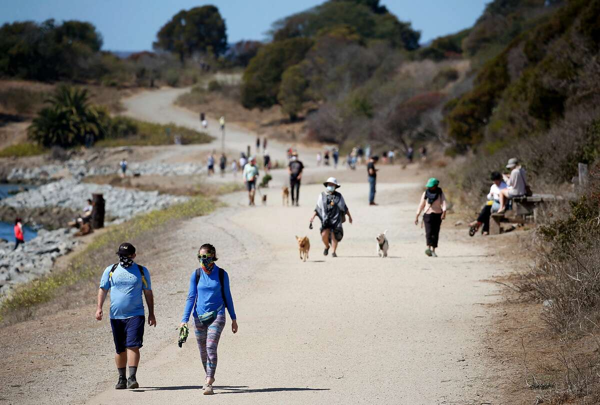 People enjoy the outdoors on the Albany Waterfront Trail in Albany on Saturday. Temperatures in parts of the East Bay could reach the 100s over the next few days.