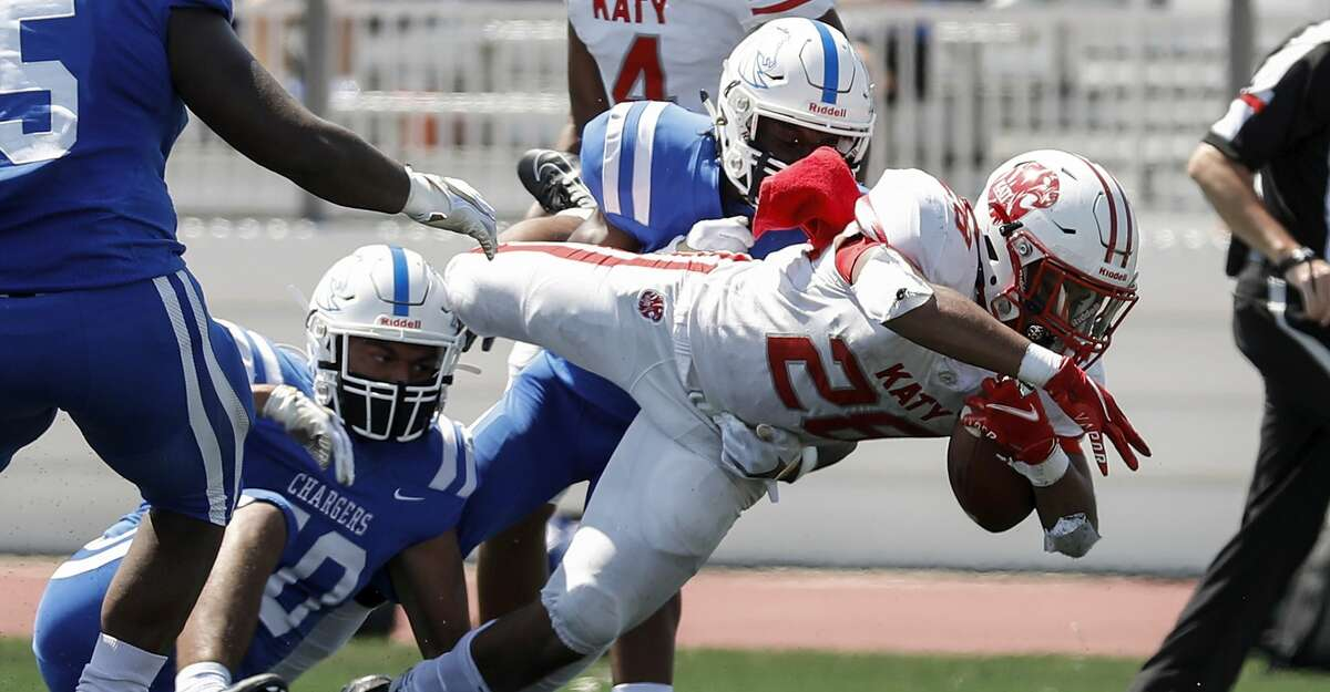 Katy Tigers Jalen Davis (28) dives for a touchdown during first half of the high school football game between the between the Katy Tigers and the Clear Springs Chargers at Challenger Columbia Stadium in Webster, TX on Saturday, September 26, 2020.