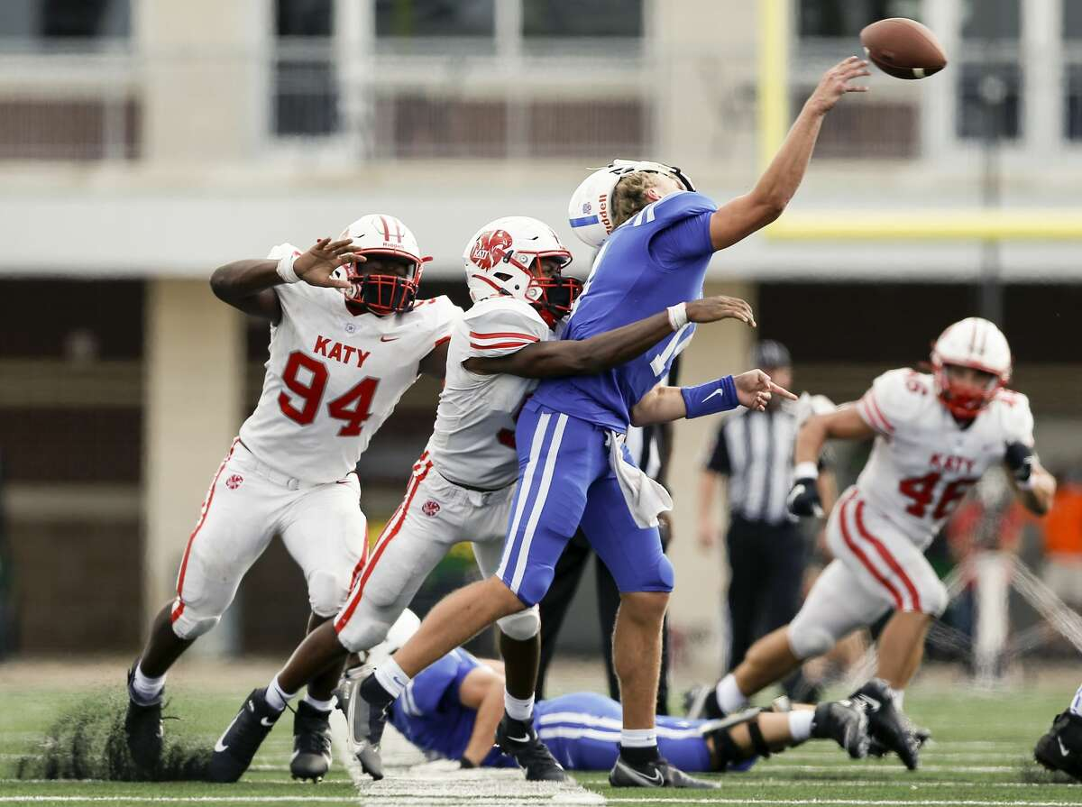 Katy Tigers Cal Varner (91) hits Clear Springs Chargers Luke Sampson (14) as he passes the ball during the second half of the high school football game between the between the Katy Tigers and the Clear Springs Chargers at Challenger Columbia Stadium in Webster, TX on Saturday, September 26, 2020. The Tigers defeated the Chargers 28-13.