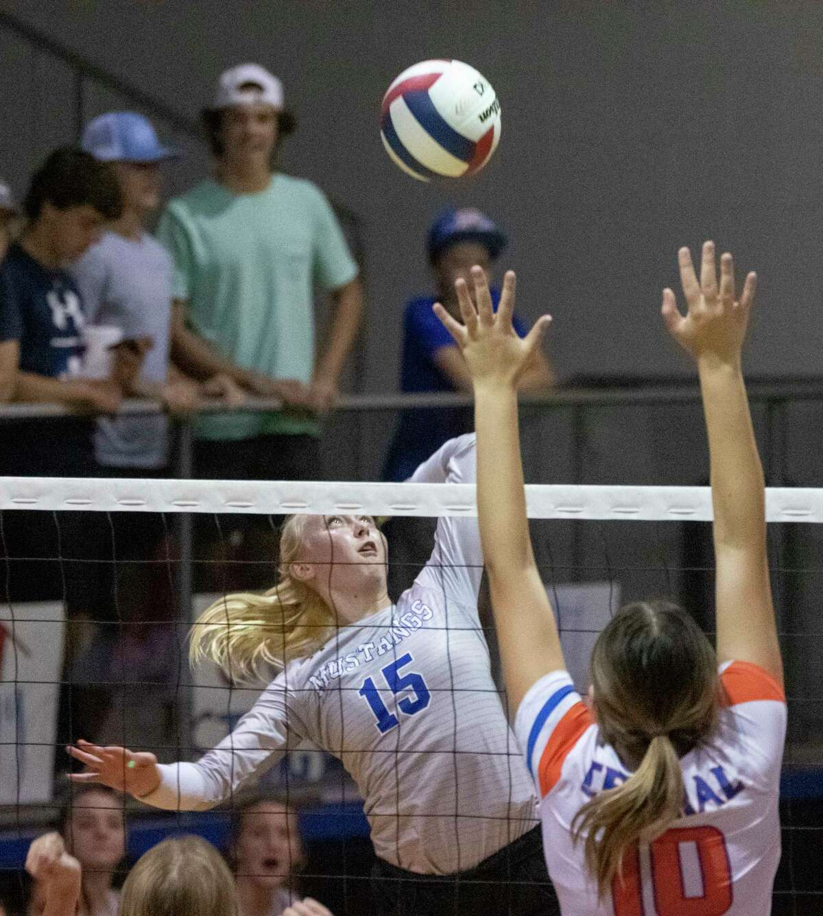 Midland Christian's Rayah Coy tries for a kill as San Angelo Central's Nadia Fierro tries to block 09/26/2020 at the McGraw Event Center. Tim Fischer/Reporter-Telegram