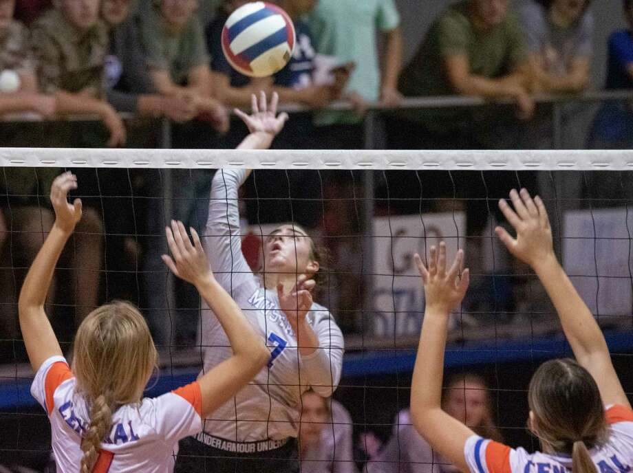Midland Christian's Marlee Prewit goes for a hit as San Angelo Central's Steely Poss and Nadia Fierro go up to block 09/26/2020 at the McGraw Event Center. Tim Fischer/Reporter-Telegram Photo: Tim Fischer, Midland Reporter-Telegram