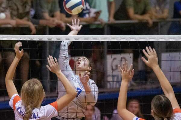 Midland Christian's Marlee Prewit goes for a hit as San Angelo Central's Steely Poss and Nadia Fierro go up to block 09/26/2020 at the McGraw Event Center. Tim Fischer/Reporter-Telegram