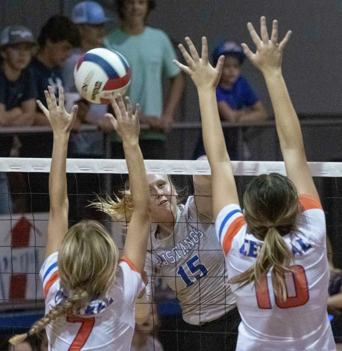 Midland Christian's Rayah Coy looks to get the ball past the reach of San Angelo Central's Steely Poss and Nadia Fierro 09/26/2020 at the McGraw Event Center. Tim Fischer/Reporter-Telegram