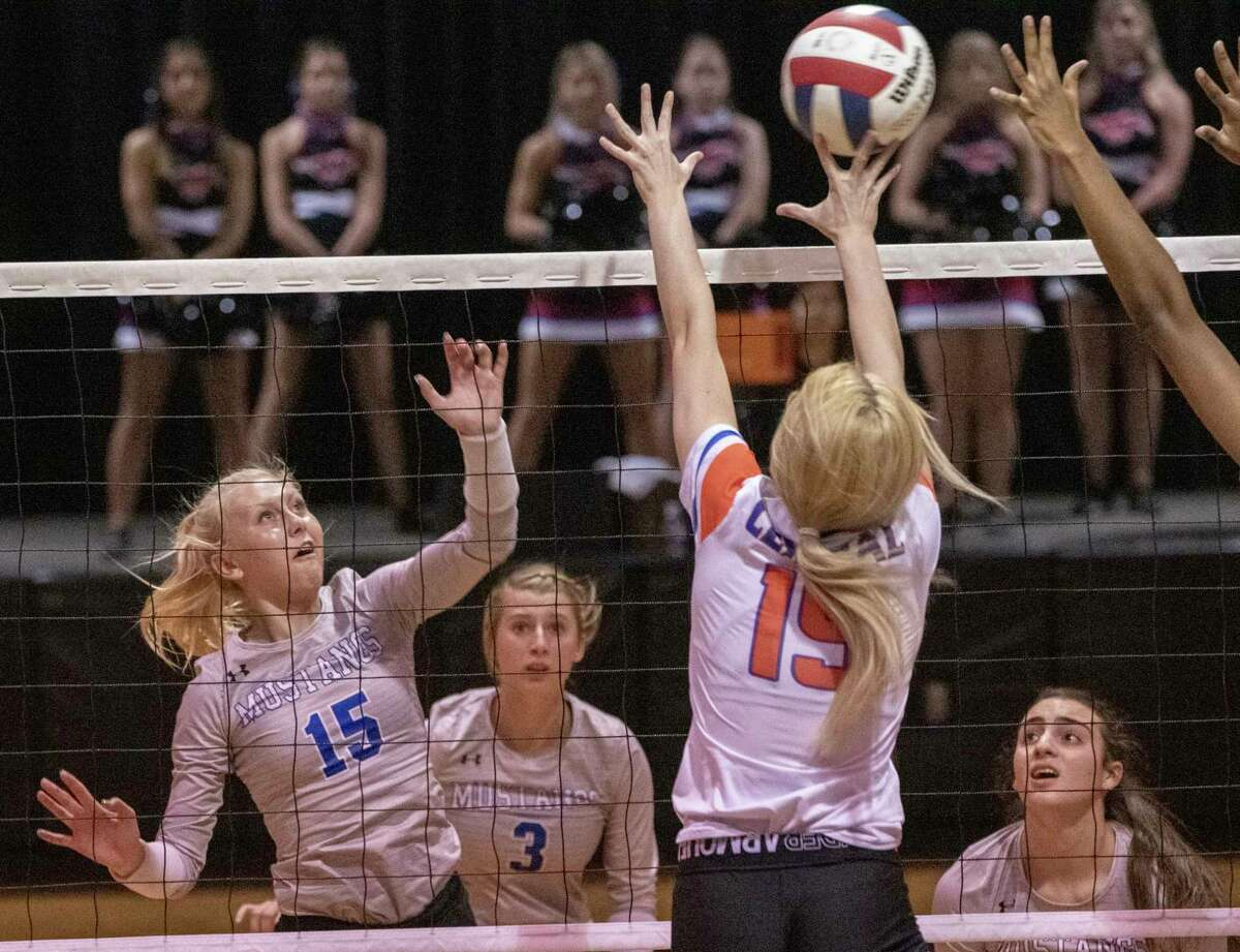 Midland Christian's Rayah Coy tries to tip the ball past the reach of San Angelo Central's Amory Fly 09/26/2020 at the McGraw Event Center. Tim Fischer/Reporter-Telegram