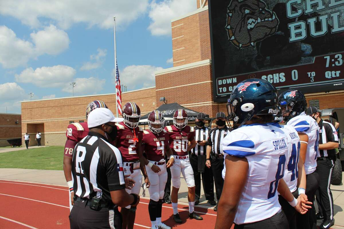 Friendswood and Summer Creek join for the coin toss before the game with officals on the sideline at Turner Stadium.
