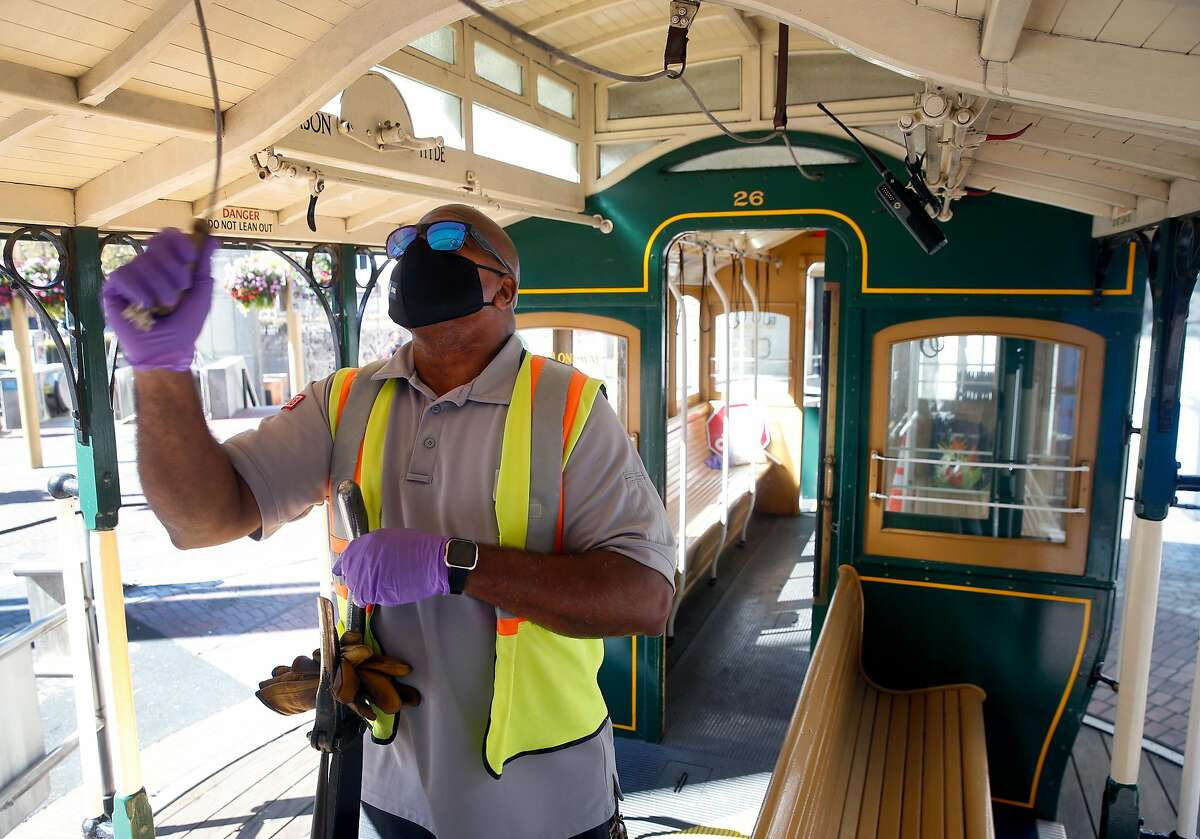 Four-time cable car bell ringing champion Leonard Oats performs on the turntable at Powell and Market streets in San Francisco.