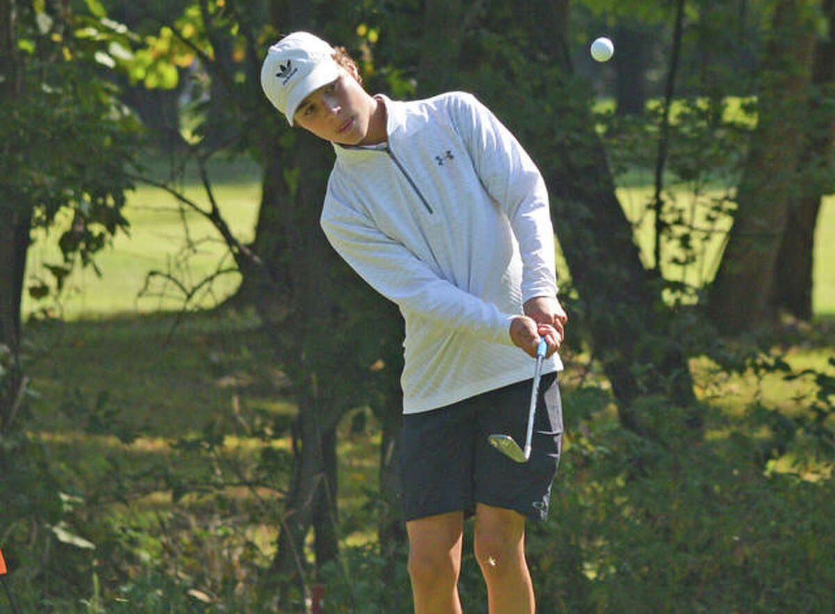 Edwardsville's Carter Crow hits a chip shot on hole No, 12 at Fox Creek Golf Course on Saturday during the second day of the Dick Gerber Invitational.