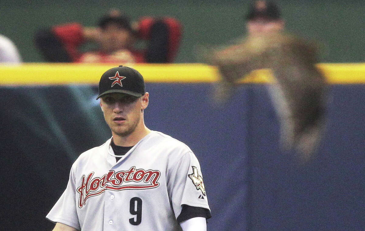 Houston Astros right fielder Hunter Pence watches as a bird flies past during the third inning of a baseball game against the Milwaukee Brewers on Sunday, April 24, 2011, in Milwaukee. (AP Photo/Morry Gash)
