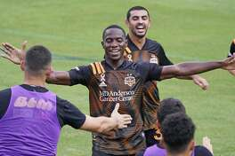 Houston Dynamo defender Maynor Figueroa, center, celebrates after scoring a goal against Nashville SC during the second half of an MLS soccer match Saturday, Sept. 26, 2020, in Nashville, Tenn. The game ended in a 1-1 draw. (AP Photo/Mark Humphrey)