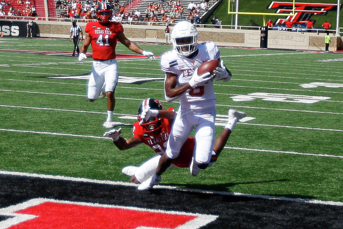 Texas wide reciever Joshua Moore makes a catch for a touchdown during the first half of an NCAA college football game against Texas Tech, Saturday Sept. 26, 2020, in Lubbock, Texas. (AP Photo/Mark Rogers)
