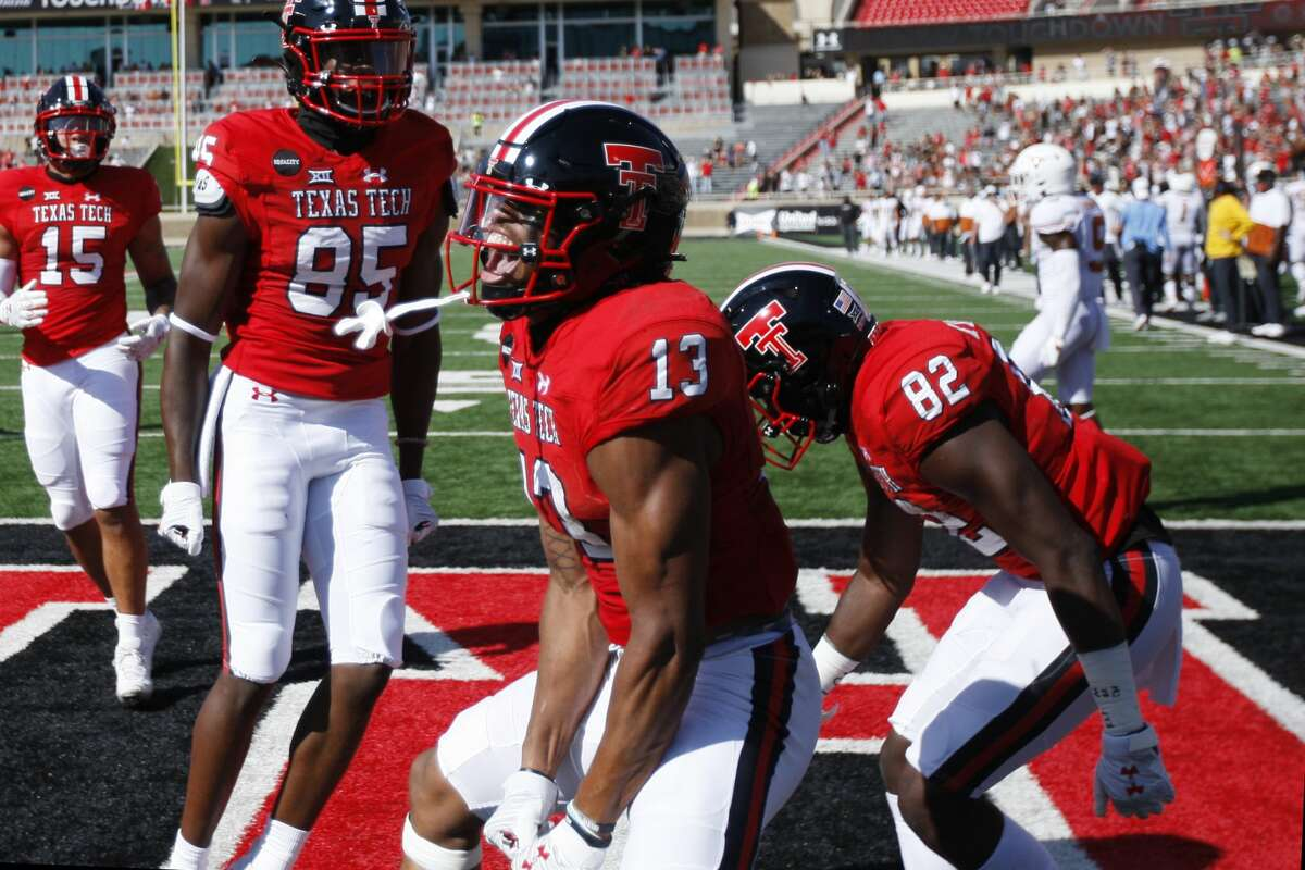 Texas wide receiver Erik Ezukanma celebrates a touchdown during the first half of an NCAA college football game against Texas Tech, Saturday Sept. 26, 2020, in Lubbock, Texas. (AP Photo/Mark Rogers)