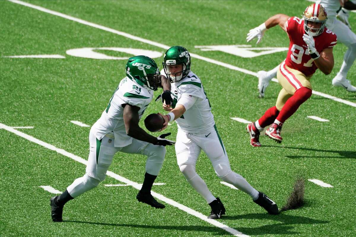 New York Jets' Sam Darnold, center, hands off to Frank Gore, left, as San Francisco 49ers defensive end Nick Bosa (97) closes in during the first half of an NFL football game Sunday, Sept. 20, 2020, in East Rutherford, N.J. (AP Photo/Corey Sipkin)