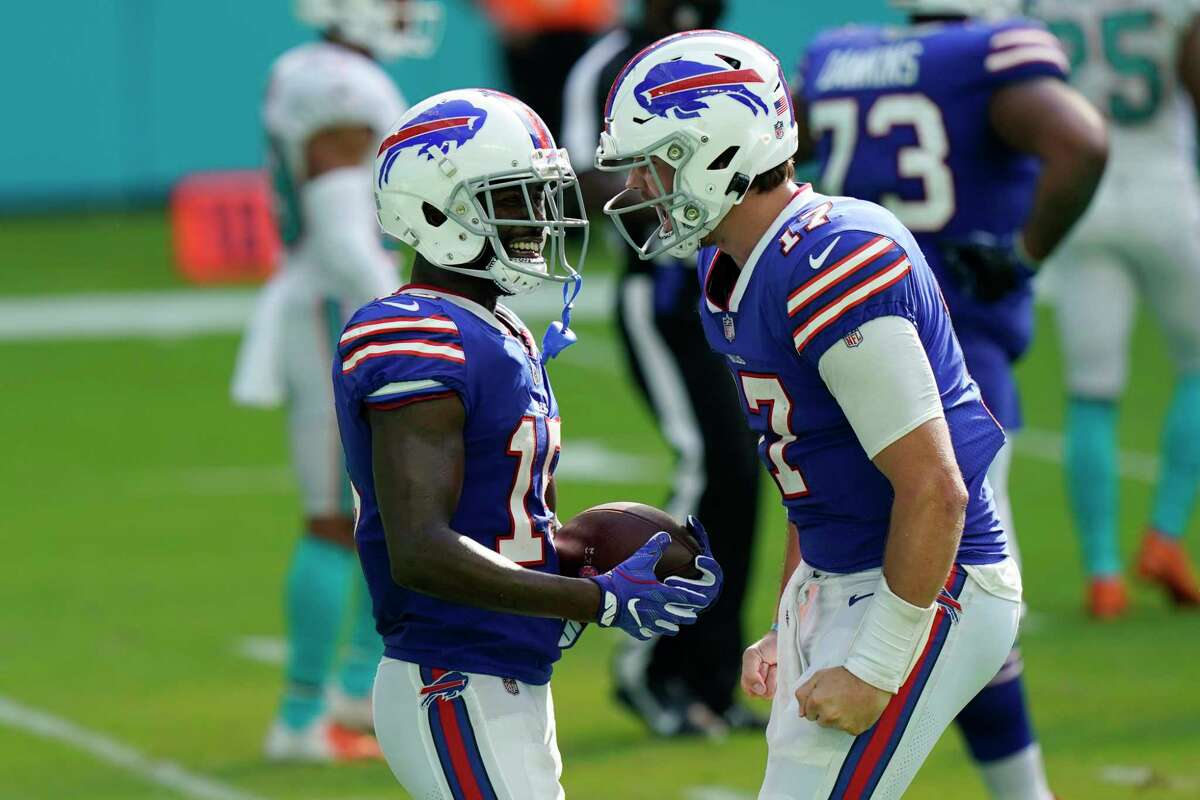 Will quarterback Josh Allen (right) and other Buffalo Bills win the Super Bowl? Will fans be allowed to watch the team's playoff games? Those are questions to be answered in 2021. (AP Photo/Lynne Sladky)