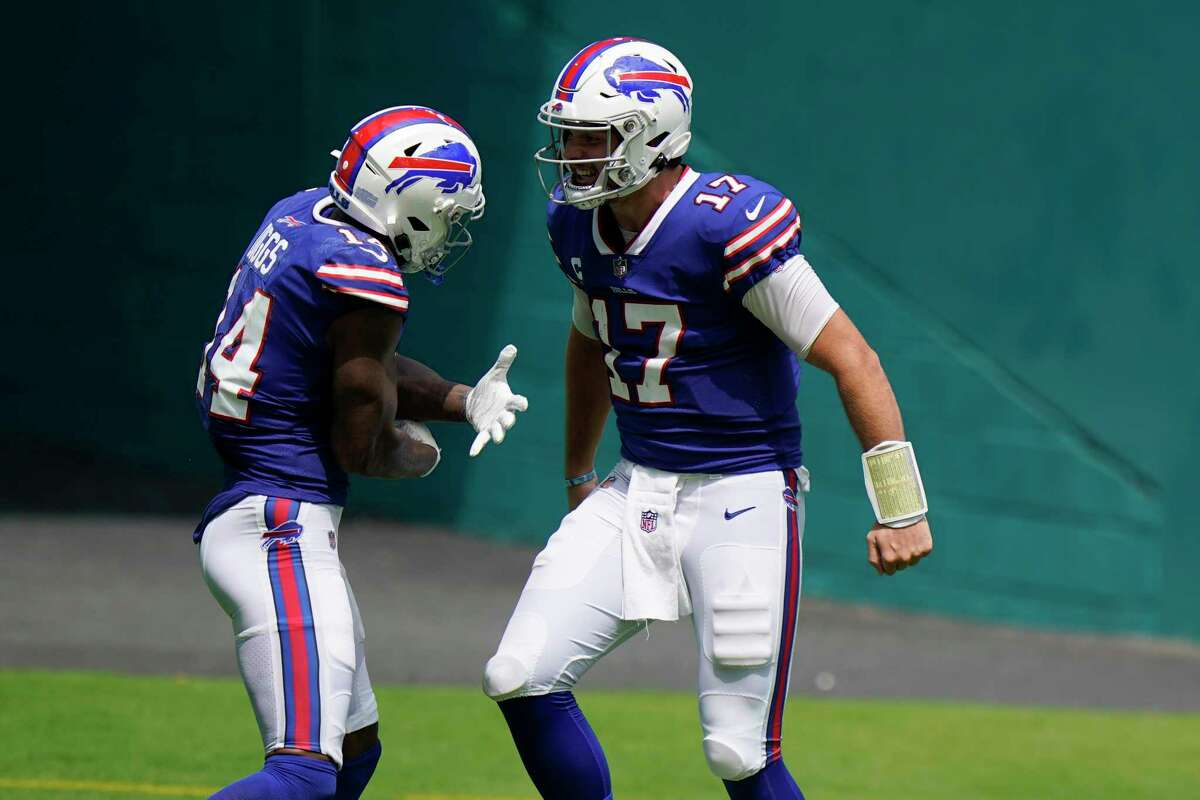 Buffalo Bills quarterback Josh Allen (17) celebrates with wide receiver Stefon Diggs (14) after Diggs scored a touchdown during the first half of an NFL football game against the Miami Dolphins, Sunday, Sept. 20, 2020 in Miami Gardens, Fla. (AP Photo/Wilfredo Lee)