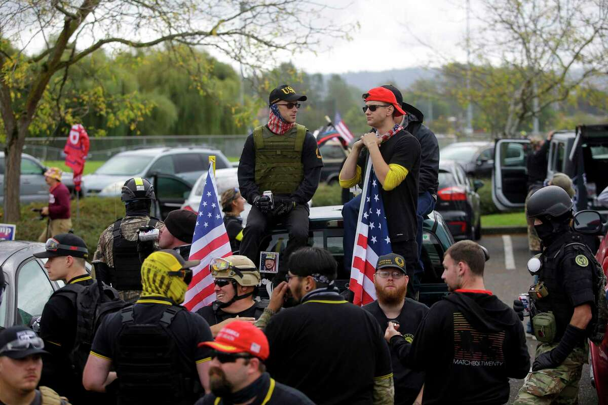 Members of the Proud Boys gather at Delta Park during a rally on Saturday in Portland, Ore. Hundreds of right-leaning activists attended the event.