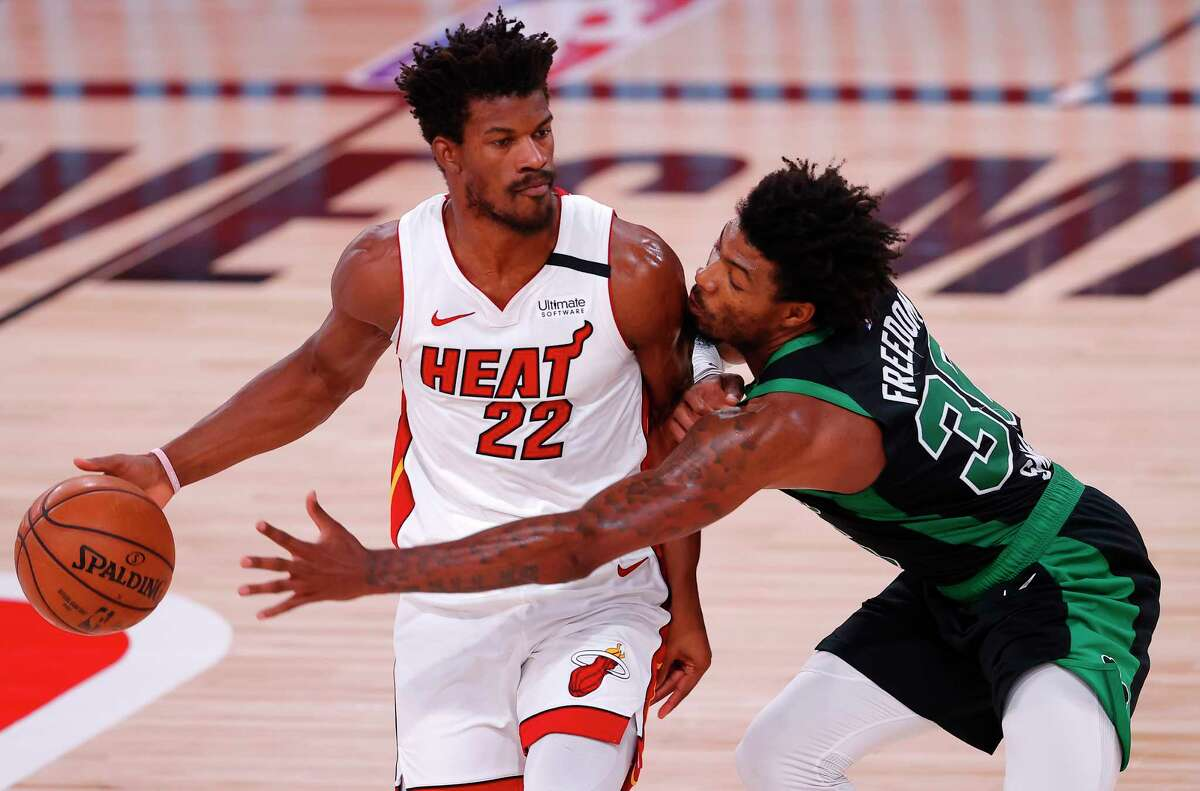 LAKE BUENA VISTA, FLORIDA - SEPTEMBER 25: Jimmy Butler #22 of the Miami Heat drives the ball against Marcus Smart #36 of the Boston Celtics during the first quarter in Game Five of the Eastern Conference Finals during the 2020 NBA Playoffs at AdventHealth Arena at the ESPN Wide World Of Sports Complex on September 25, 2020 in Lake Buena Vista, Florida. NOTE TO USER: User expressly acknowledges and agrees that, by downloading and or using this photograph, User is consenting to the terms and conditions of the Getty Images License Agreement. (Photo by Mike Ehrmann/Getty Images)